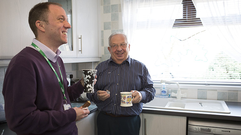 Bill and Tony share drink tea in the kitchen