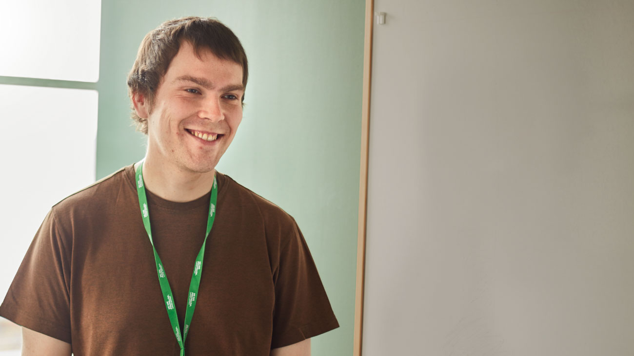 Chris, a welfare rights adviser in his 30s, smiling.
