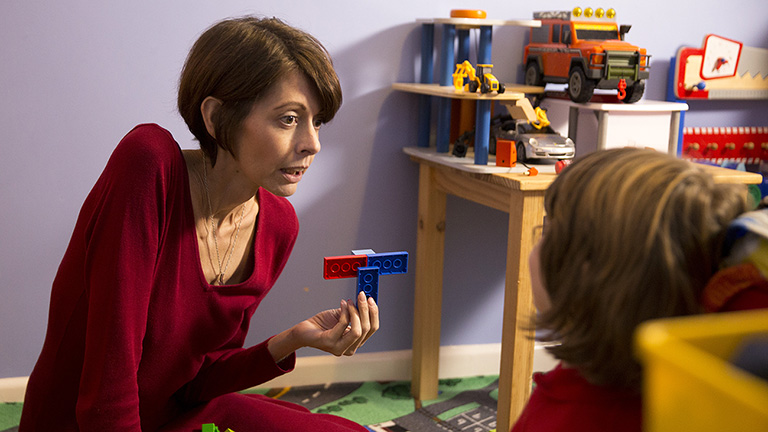 Claire playing Lego with her son