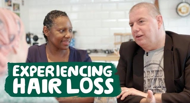 A man and two women are sat at a table, the words 'experiencing hair loss' are written along the bottom.