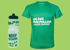 A green Macmillan tshirt next to a Macmillan water bottle.