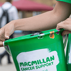 Image of someone holding a Macmillan Cancer Support donation bucket