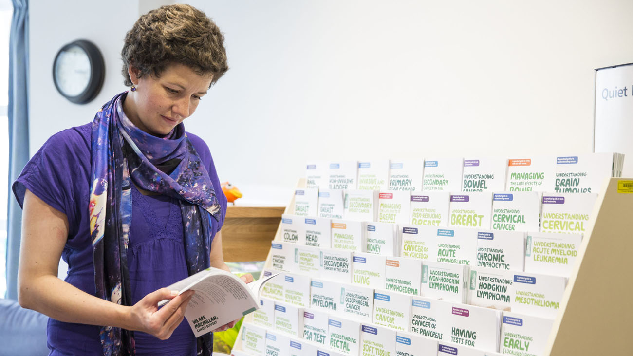 Kate reading a Macmillan booklet