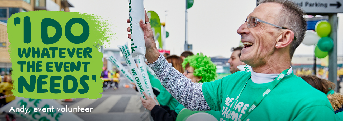 Andy, a Macmillan volunteer, cheers at a running event. Overlaid text reads, 'I do whatever the event needs.'