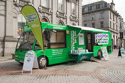 One of Macmillan's information and support buses parked in a high street