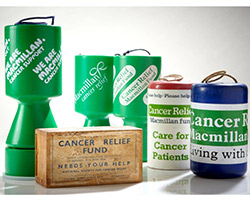 A collection of Macmillan donation boxes, old and new.