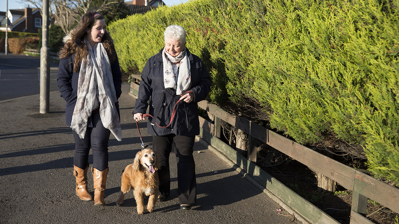 Philomena on a walk with her dog and granddaughter, Megan.