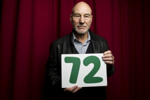 Campaign supporter Patrick Stewart is holding a card showing the number 72.