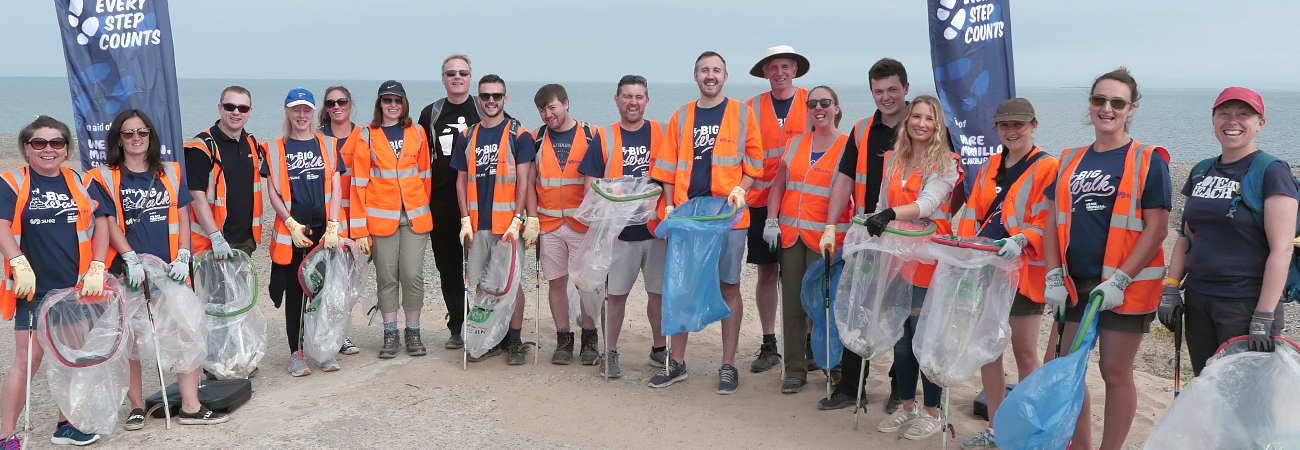 SUEZ employees on a beach for The Big Walk fundraising event in aid of Macmillan Cancer Support.