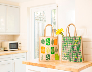 Two tote bags sitting on a kitchen counter.