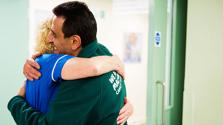 Mario hugs his Macmillan nurse