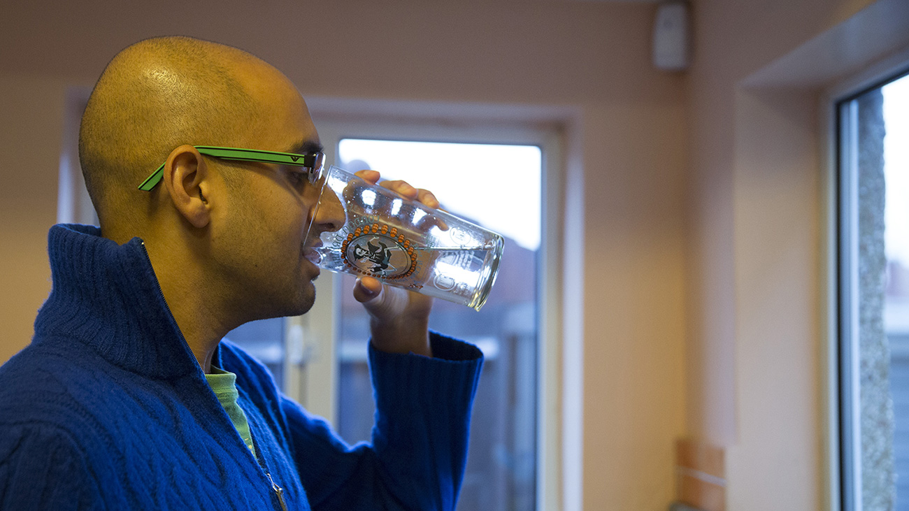 Vivek drinking a glass of water