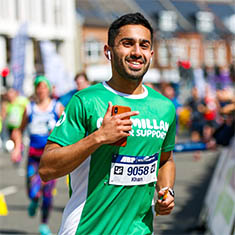 A Macmillan runner wearing a green t-shirt
