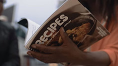 An image of a woman holding a recipe book.