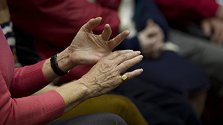 Gesticulating hands close up at a support group