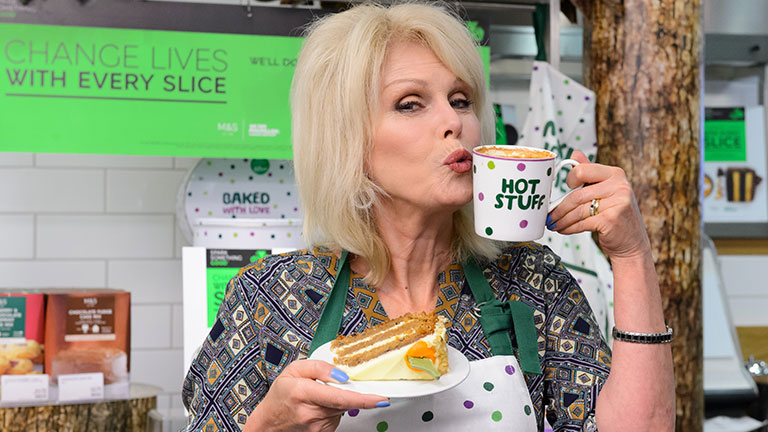 Joanna Lumley pouting and holding a mug of tea.