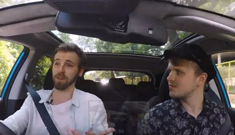 Justin and Matt having a conversation in a car.