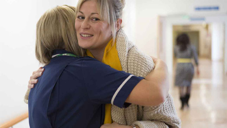 Kate hugs a Macmillan nurse