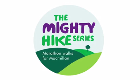 A round badge showing hills and a tree, with the words 'Macmillan Mighty Hike series - Marathon walks for Macmillan.'