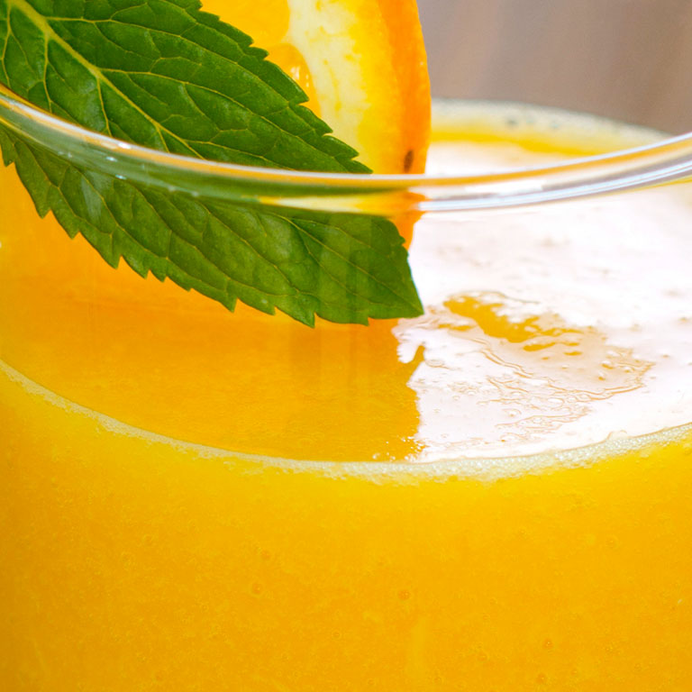 Orange juice and mint leaves