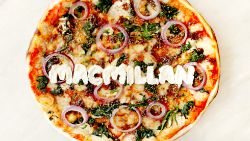 A padana pizza from PizzaExpress. 'Macmillan' is written in mozzarella cheese.