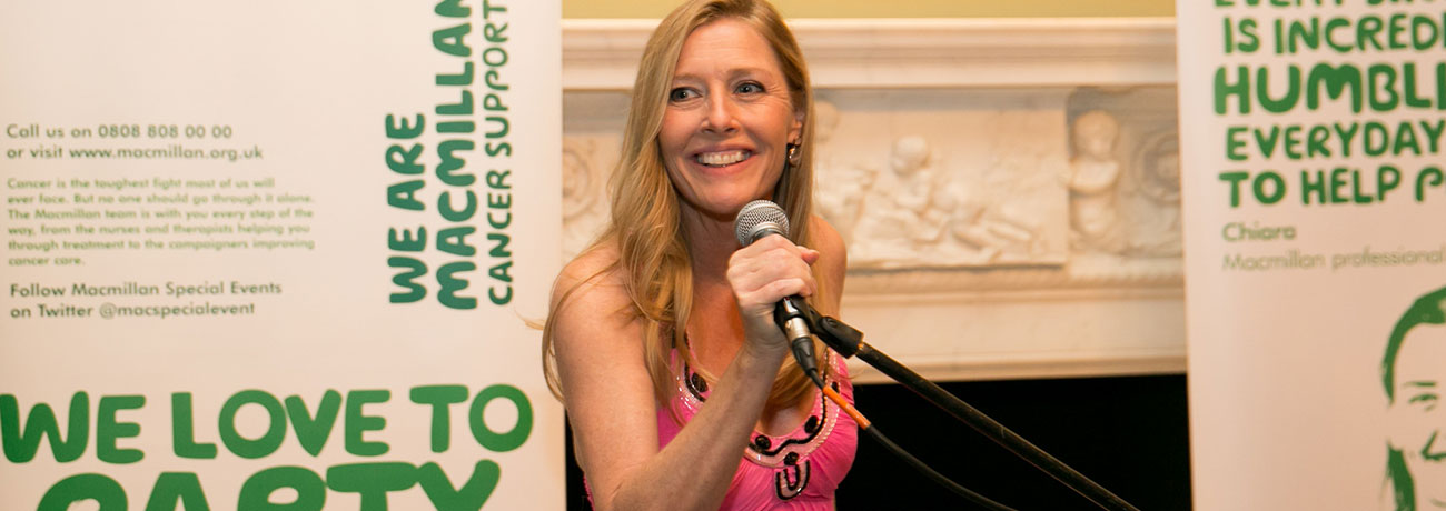 Celebrity designer Sophie Conran speaks at a microphone at a Macmillan event.