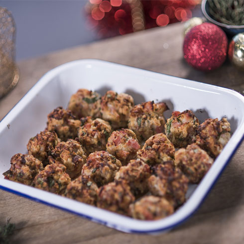 A dish of Christmas stuffing surrounded by festive decorations.