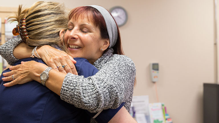 Claire hugs a female Macmillan nurse called Shez.