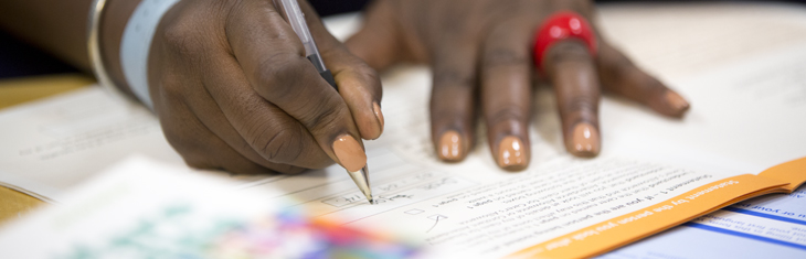 A person completing a form.