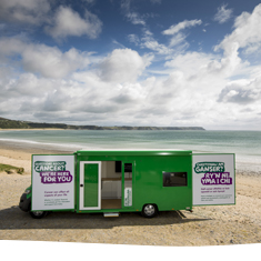 Bronwyn - the mobile cancer information bus on a beach in Wales.