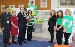 Andy Slaughter MP with representatives from Macmillan and Imperial Trust officially launch the service with an oversized pair of cardboard scissors.