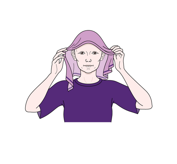 Image showing a person tying the ends of a scarf into a double knot behind their head and over the triangle point of the scarf, with the flap underneath the knot.