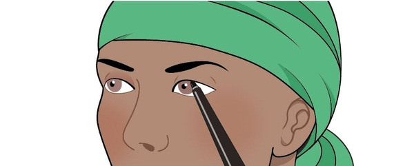 An illustration of a woman who is creating natural-looking eyelashes using make-up. She is applying the make-up lightly, to make sure the eyelashes are well defined and look natural. This illustration shows the second step of a two-step process for creating natural looking eyelashes.