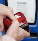 Hands searching through purse for money for parking meter