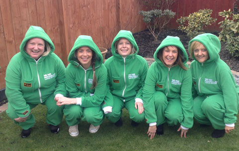 Macmillan Northumberland team wearing on-brand onesies