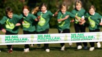 Macmillan banner and kids running in the background