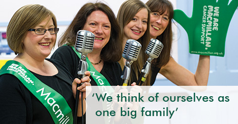 Susan and three members of her theatre group, with the words 'We think of ourselves as one big family'.